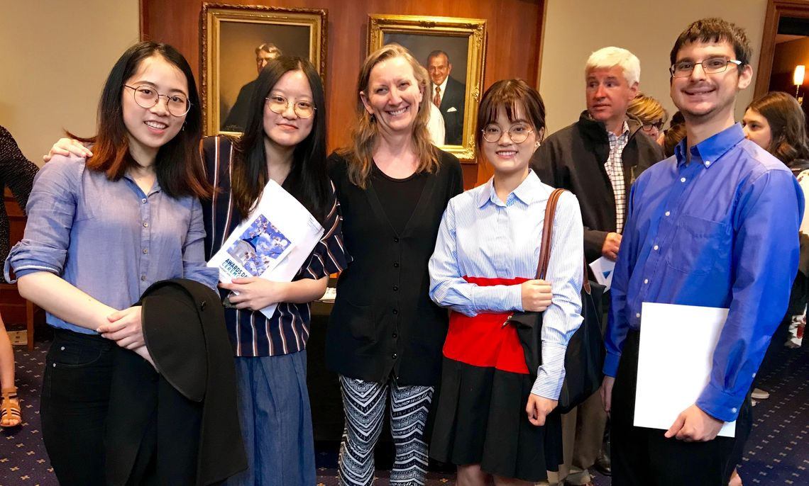 A few of the sixteen math Kershner Scholar awardees pose here during the annual All-Campus Awards Program in the Barshinger Center for the Musical Arts. From left:  Yifei Sun '19, Yunhong (Mabel) Li '19, Math Prof. Barbara Nimershiem, Xinyang Chen '20 and Yoni Weiss '20.