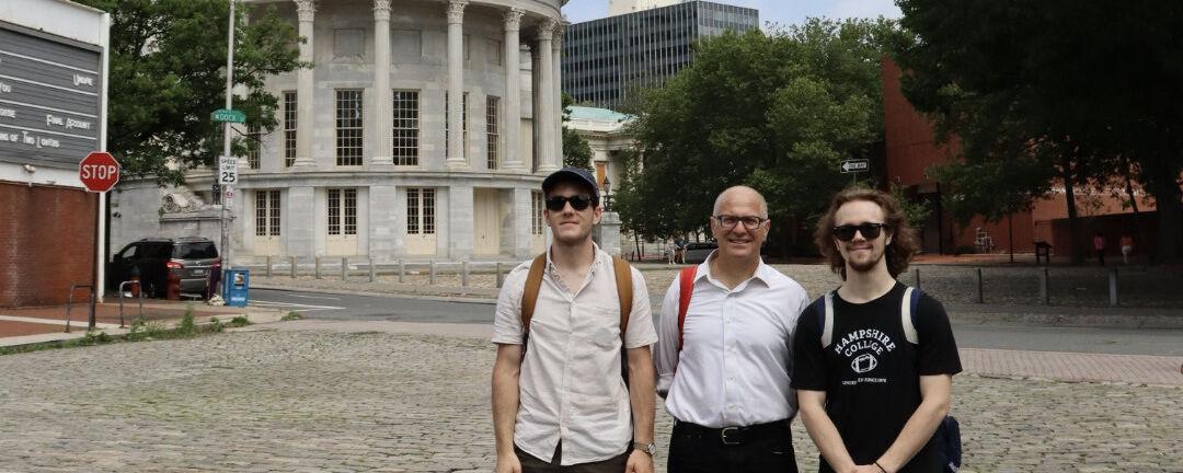 Students Corlett and Saunders with Professor Kourelis at the Exchange in Philadelphia.