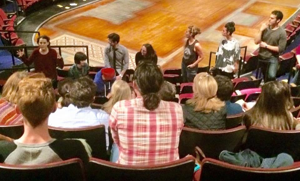 Broadway's Circle in the Square has the stage in the middle of the seating area, giving each audience member a distinctive perspective. Here, students listen to the perspectives of the cast and production crew.