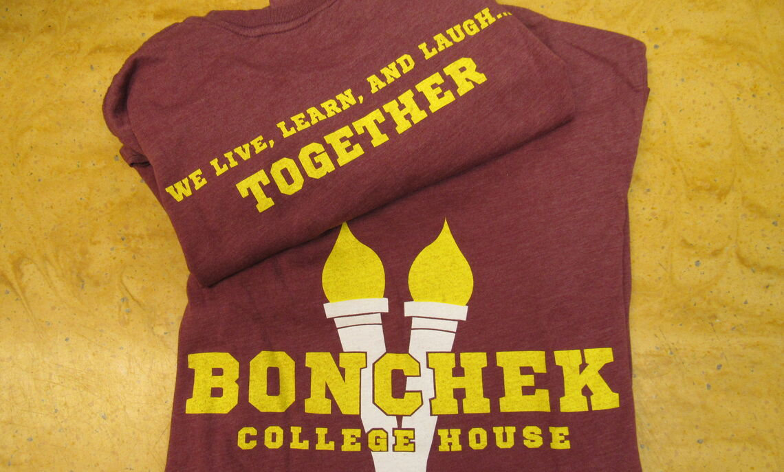 Bonchek's Torch logo shirt. Available in short sleeve. Motto on the back.