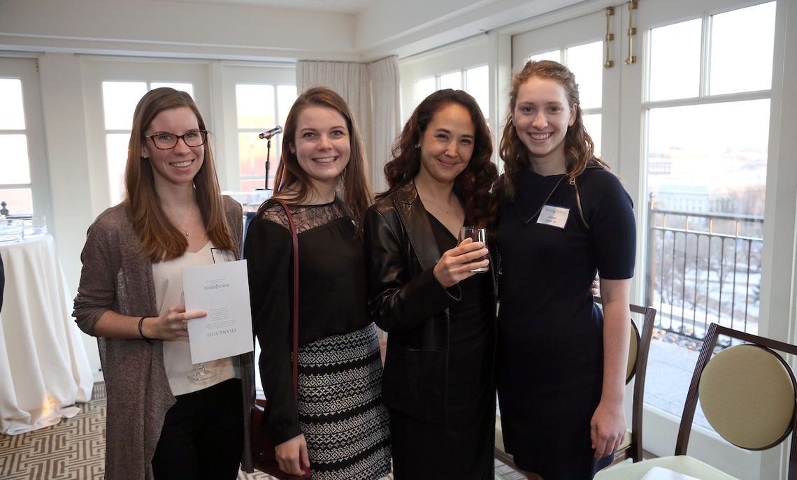 ... Assistant Professor of Government Nina Kollars, third from left, here with alumnae.