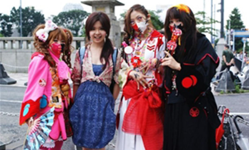 "Gabby Jiayin She, second from left, poses with some of the """"Living Dolls of Tokyo"" during her summer research project in Japan."