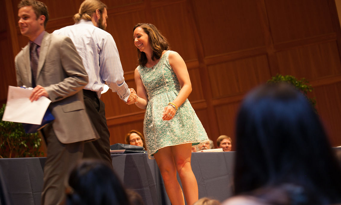 Students of the Class of 2014 (Andrew Meriwether and Caitlin Brust)  participate in the annual Senior Awards Ceremony in the Barshinger Center for Musical Arts.