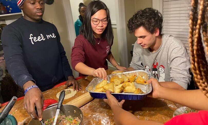 """In this 2019 file photo, students enjoy a """"Taste of Africa"""" cooking demonstration in the Black Cultural Center kitchen, complete with Ethiopian sambusas and Nigerian meat pies."""
