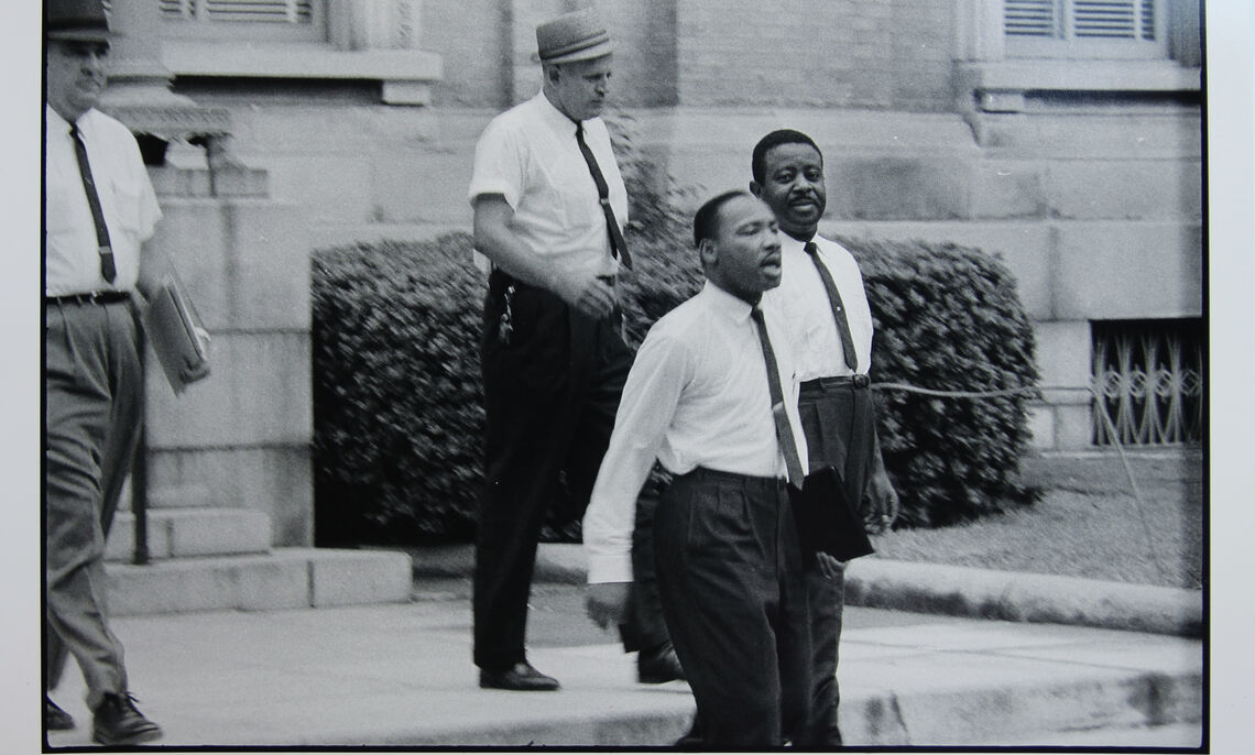 """Danny Lyon (America, b. 1942). Dr. Martin Luther King, Jr. and Reverend Ralph Abernathy are escorted back to jail in Albany, Georgia, 1962. Gelatin silver print, printed later, 11 x 14"""". Gift of Dr. and Mrs. Stephen Nicholas."""