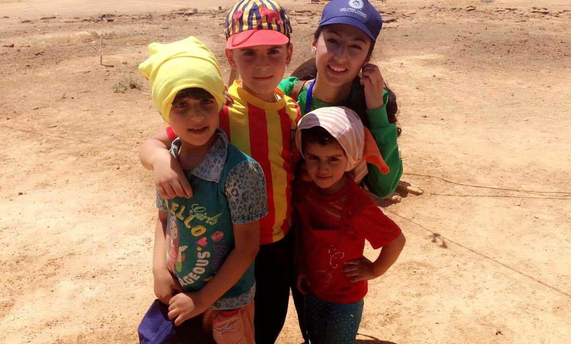 """""""I still remember the kids, every single day,"""" says  Sonia, here with a few of the refugee children. """"I want to go back and hug them."""""""