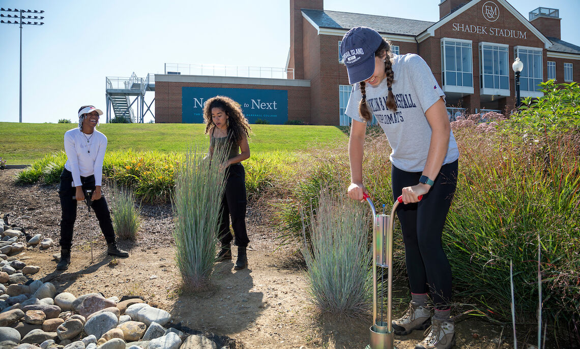 Students in Sybil Gotsch's ecohydrology lab collect data from rain gardens outside Shadek Stadium as part of a comprehensive study.