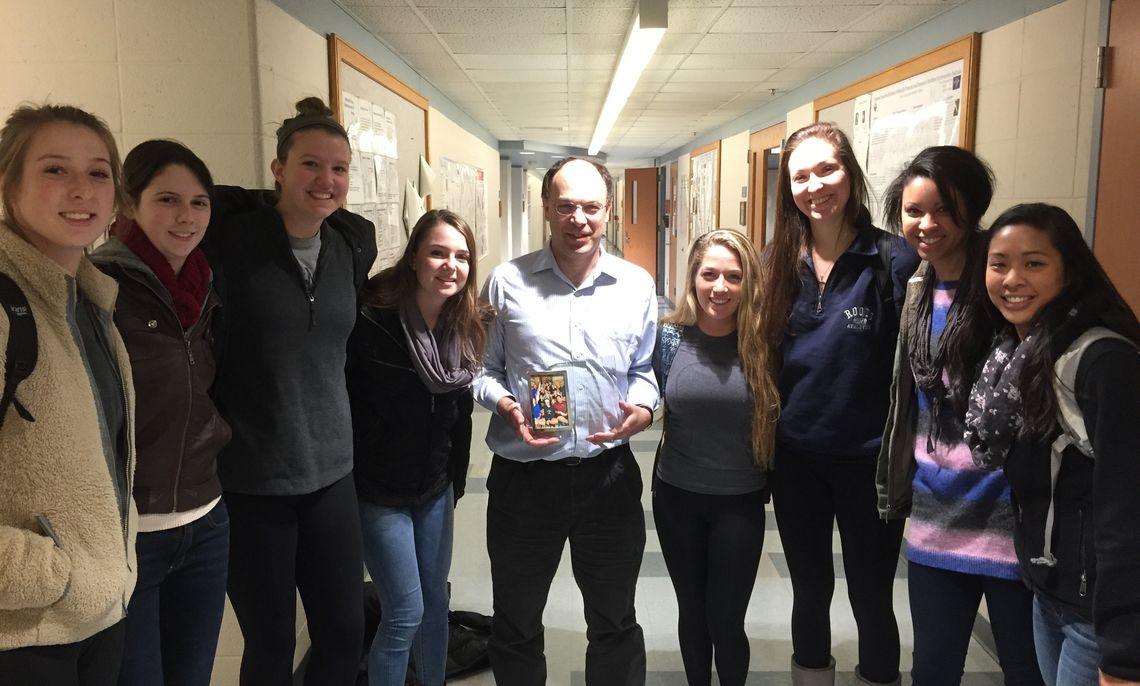 Eight members of Franklin & Marshall's Volleyball Team, which won the Centennial Conference championship this year, honors their academic liaison, Professor of Chemistry Rick Moog.