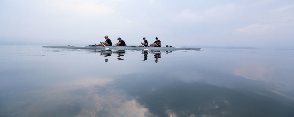 The men's team pauses for a rest during a still moment on the water during an early morning practice on the Susquehanna River. Pictured (l-r) are James Nelson '17, Jonathan Munro '17, Samuel Alter '15, Timothy Smith '15 and Amanda Levit '15.