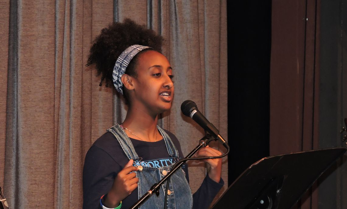 Delivering a spoken word for the talent show