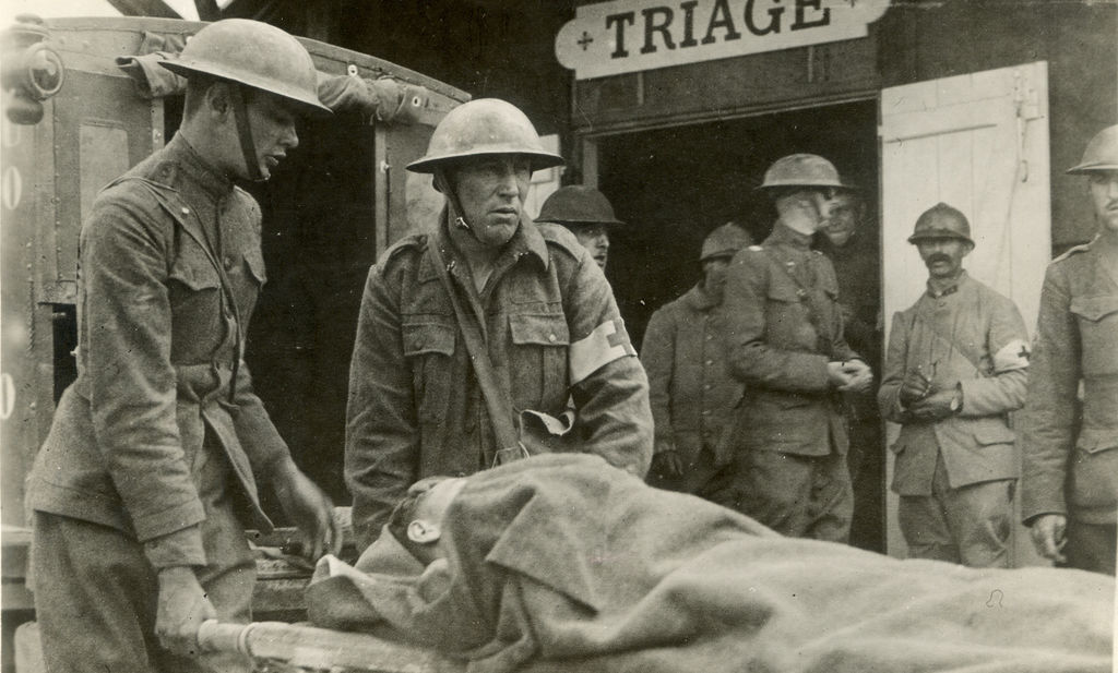 American soldiers bring the wounded to a French field hospital.