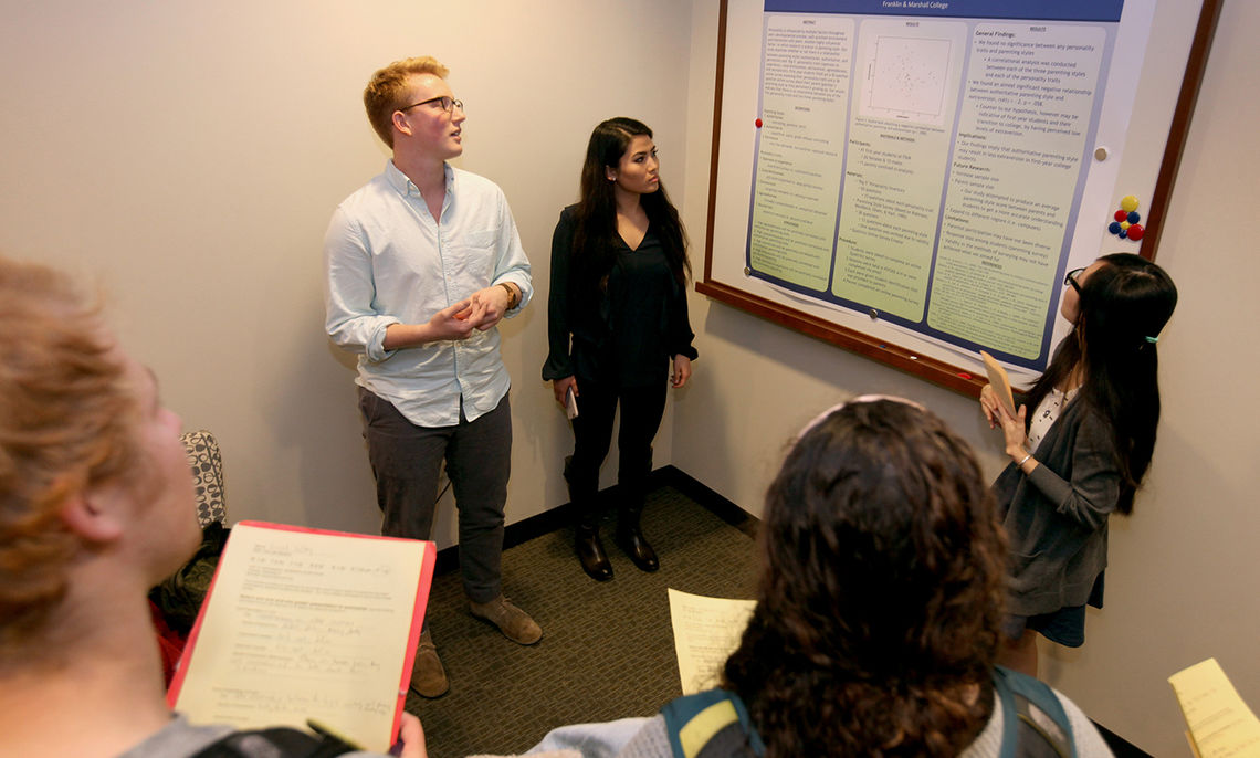 """Kathy Doung, Hunter Siegrist and Tina Yin present their poster, """"The Relationship Between the Big Five Inventory and Perceived Parenting Style for First-Years."""""""
