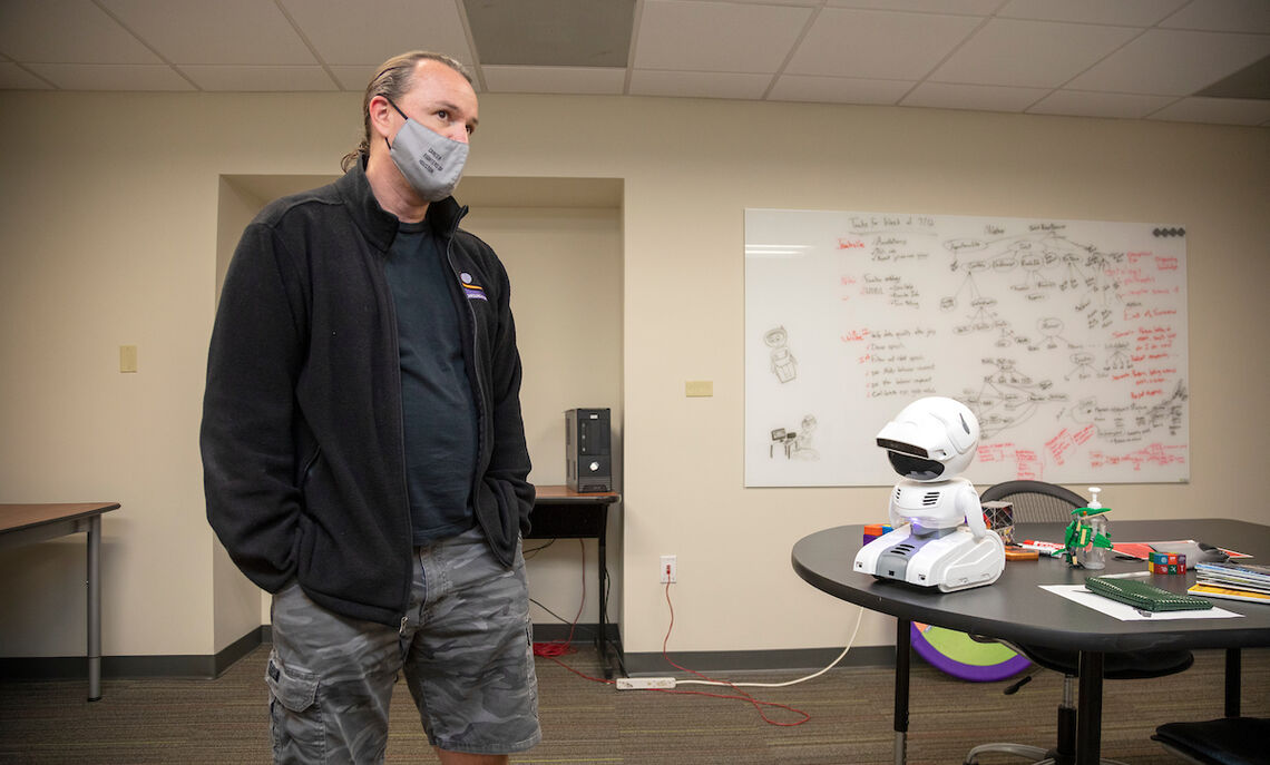 """Computer Science Professor Willie Wilson, left, says, """"In designing the robot, we incorporate concepts from psychology, philosophy and occupational therapy."""""""