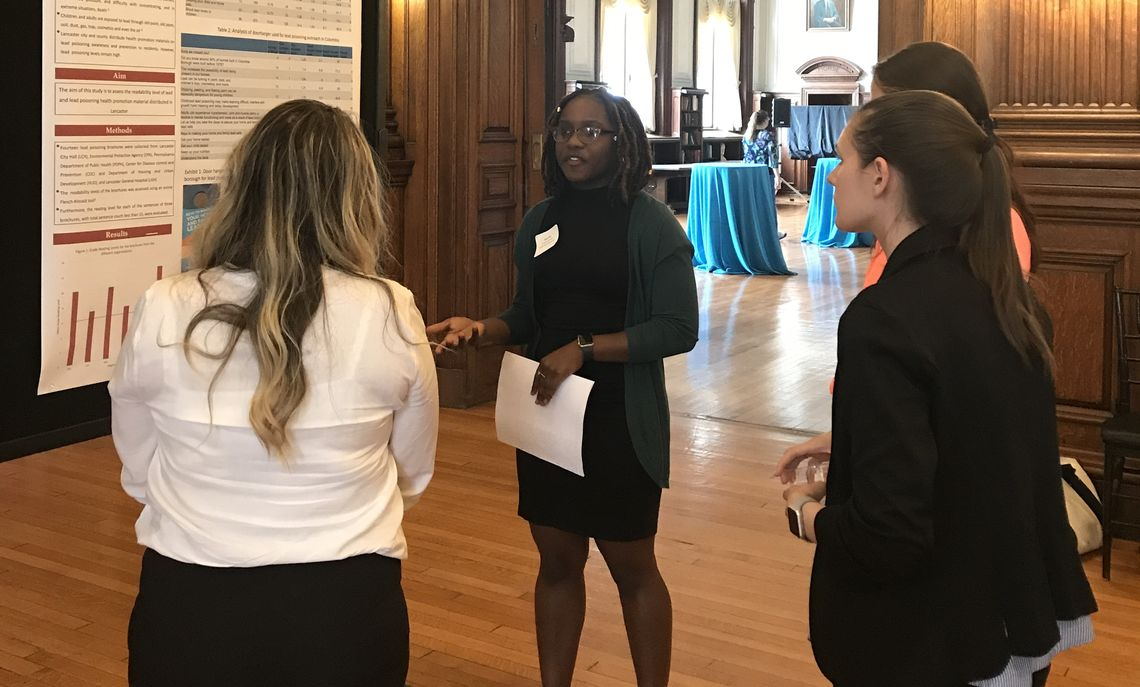 Ebony Pitts, a junior American studies and public health joint studies major, shares with conference attendees her findings on the readability of government literature regarding lead poison.