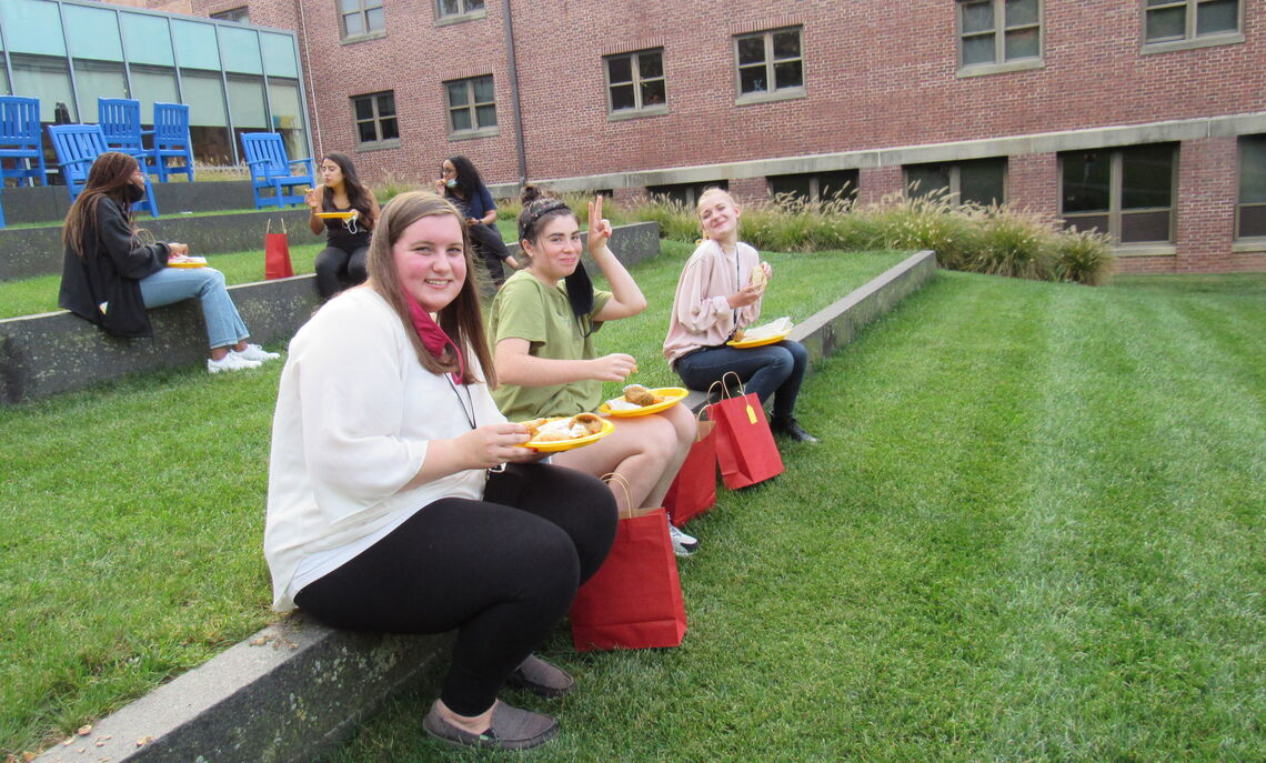 A group from Bonchek enjoying the food from the festival