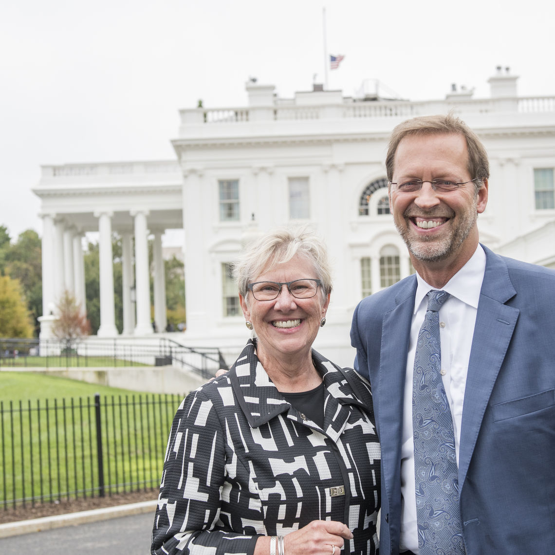 F&M Board Chair Sue Washburn '73 joined Porterfield at the White House ceremony.