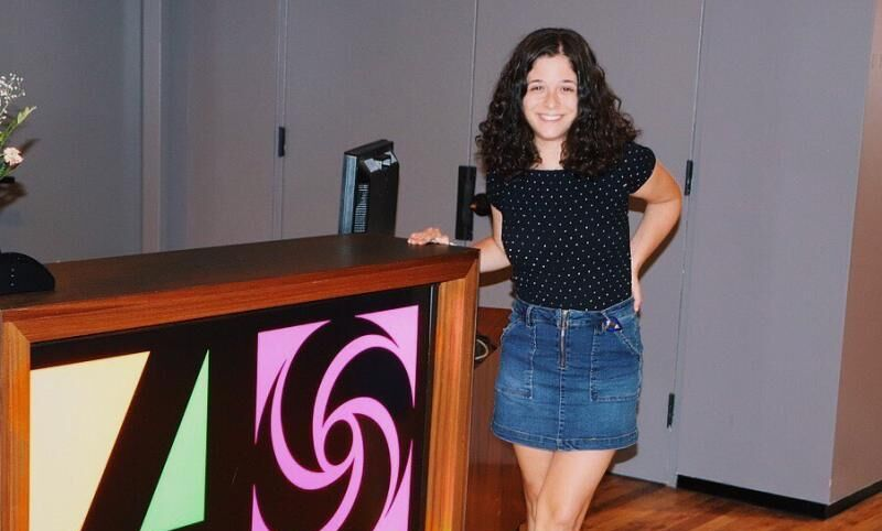 Elena Robustelli '21 poses by the sign for Atlantic Records, a recording label she interned with.