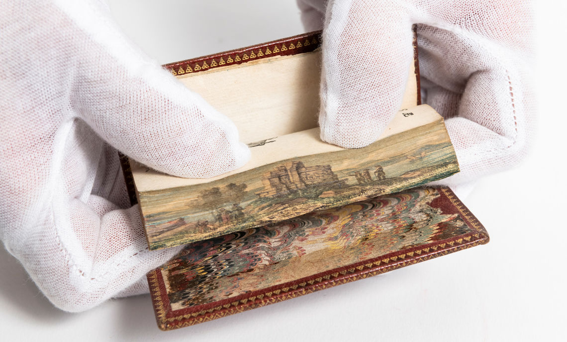 """Manassae Oratio, Esdrae lib. II & IV: Cun Indice Bibliorum Triplici"" includes a fore-edge painting of Roman Ruins."