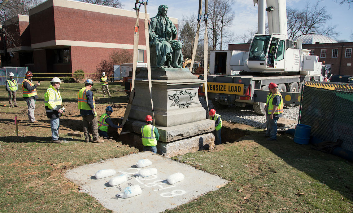 In moving the de Peyster statue, crews set out bags of ice on the pad of its new home. The ice provided some space, once the crane set the more than 22-ton edifice down, so the crews could remove the straps used to carry it.