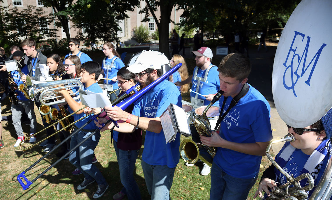 Pep Band leader Paul Murray and his blue trombone and the rest of the band entertain Tailgaters with their music before leaving for the grandstand of Sponaugle-Williamson Field, where they helped cheer the Diplomats on to victory over McDaniel Saturday afternoon.