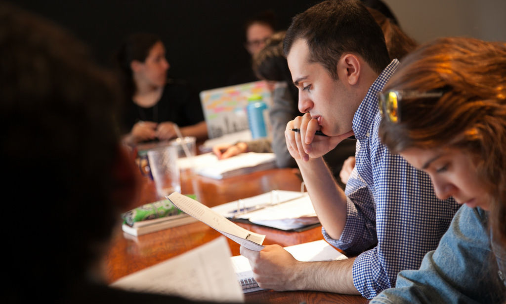 English Department professor Nicholas Montemarano teaches a class in the Writer's House.