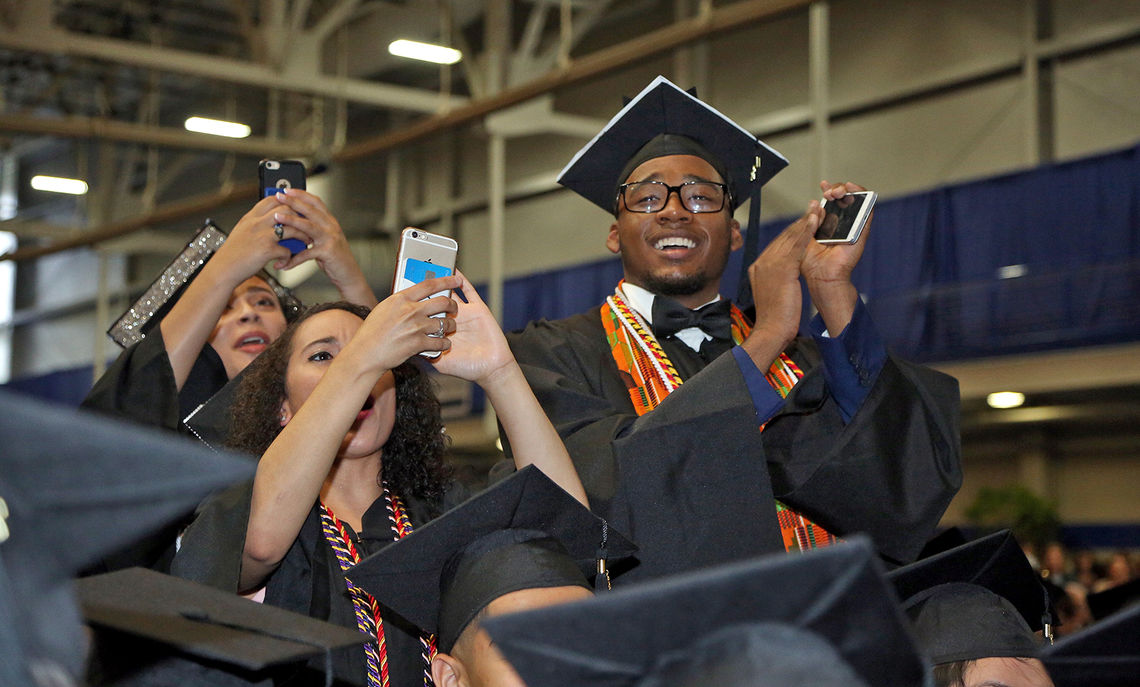 Exuberant members of F&M's Class of 2017 snap photos of their friends receiving their diplomas during the May 13 Commencement ceremony.