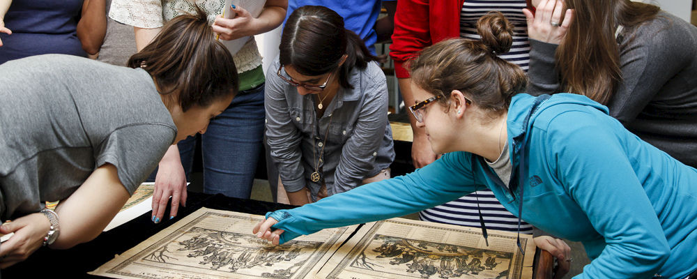 F&M students are shown here examining some ancient texts.