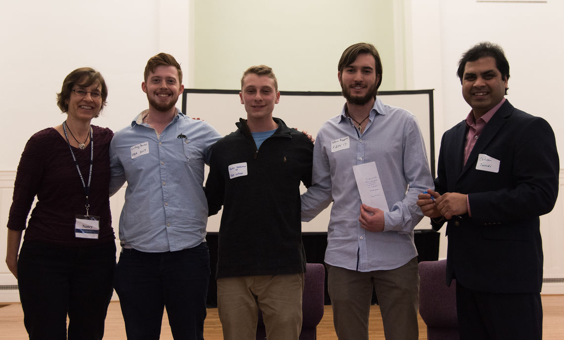 Professor Nancy Kurland with the winning F&M seniors, from left to right, Colbey Davies, Aaron Hoffman, and Fed Ruggiero, and joined by Gettysburg Professor Chitin Trivedi.