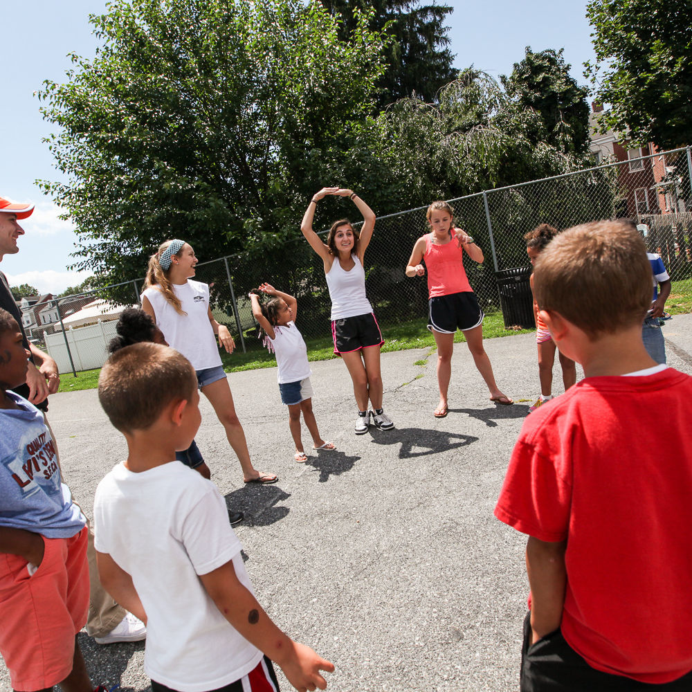 At Wharton Elementary, F&M students play a game with kids during their summer program.
