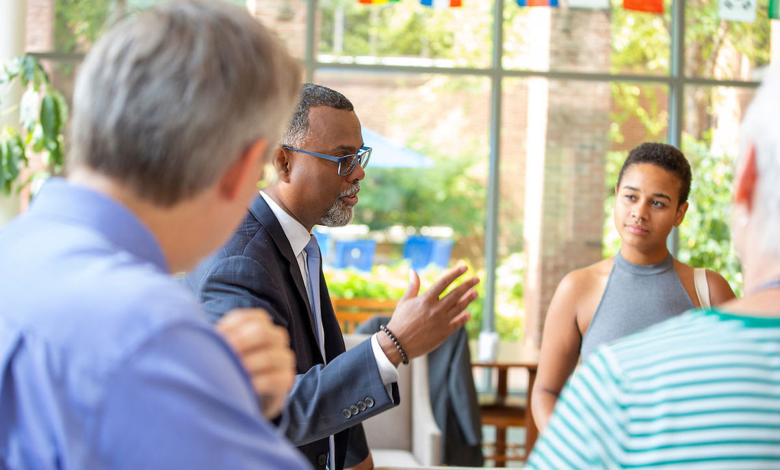 Professor Eddie S. Glaude speaking with members of the F&M community at a reception following his talk.
