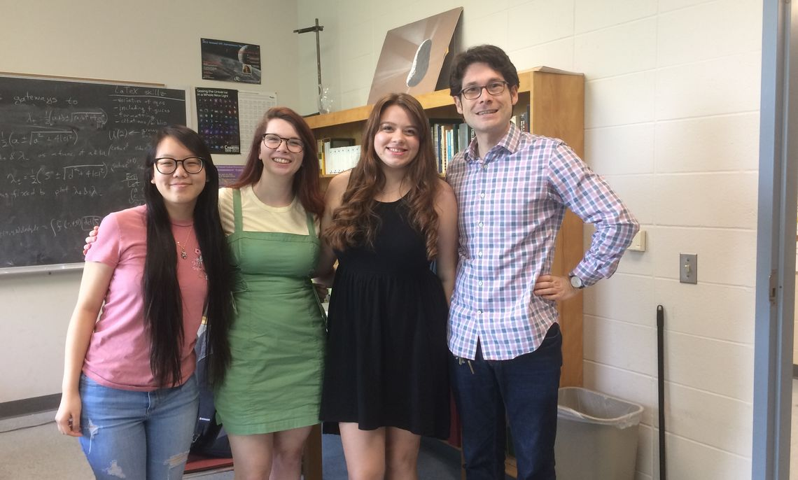 Visiting Assistant Professor of Physics and Astronomy Curtis Asplund and his Hackman research scholars, from left to right, Ileane Ho, Sandy Chilson and Elisa Panciu.