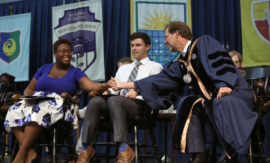 Junior Jyra Jones and senior Gregory Fullam with F&M President Daniel R. Porterfield congratulating her for her remarks.