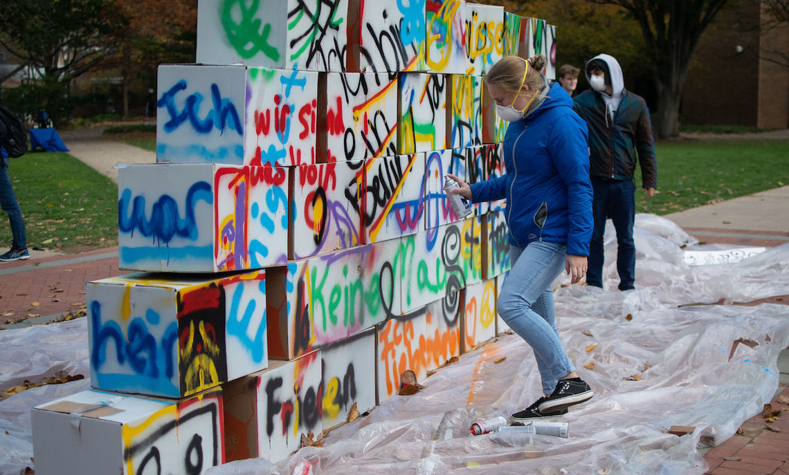 Throughout the morning, as light winds kicked up, students painted graffiti in German on the wall.