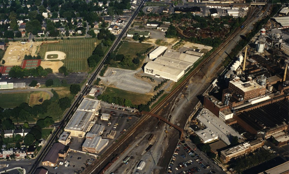 1988: This aerial photo taken in the summer of 1988 shows the industrial tract that F&M is developing as its North Campus. On the right (north) side is the bustling Armstrong plant, with the Norfolk Southern rail yard and steel pedestrian bridge to its south. John Marshall's likeness is visible on the College's former ice rink, near the center.