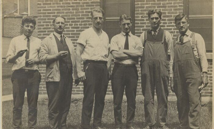 Group of men posed in front of Stehli Silk Mill, 1920