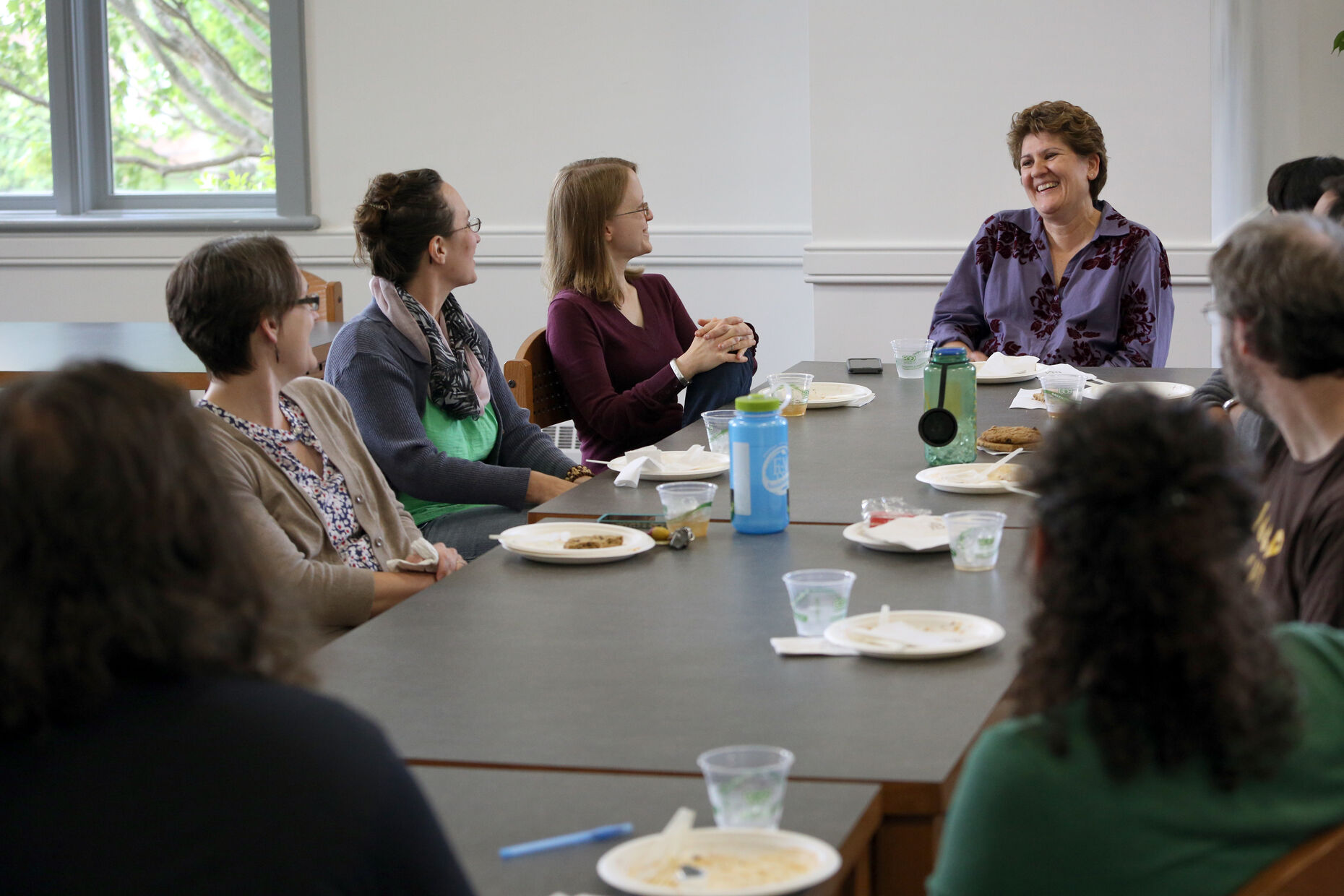 Faculty gather for a working lunch discussion.
