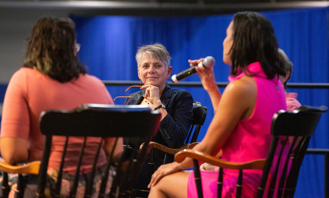 F&M President Barbara Altmann listens as alumnae Michelle Flatt '99, vice president of programs at an organization for women in technology, shares her professional experiences.