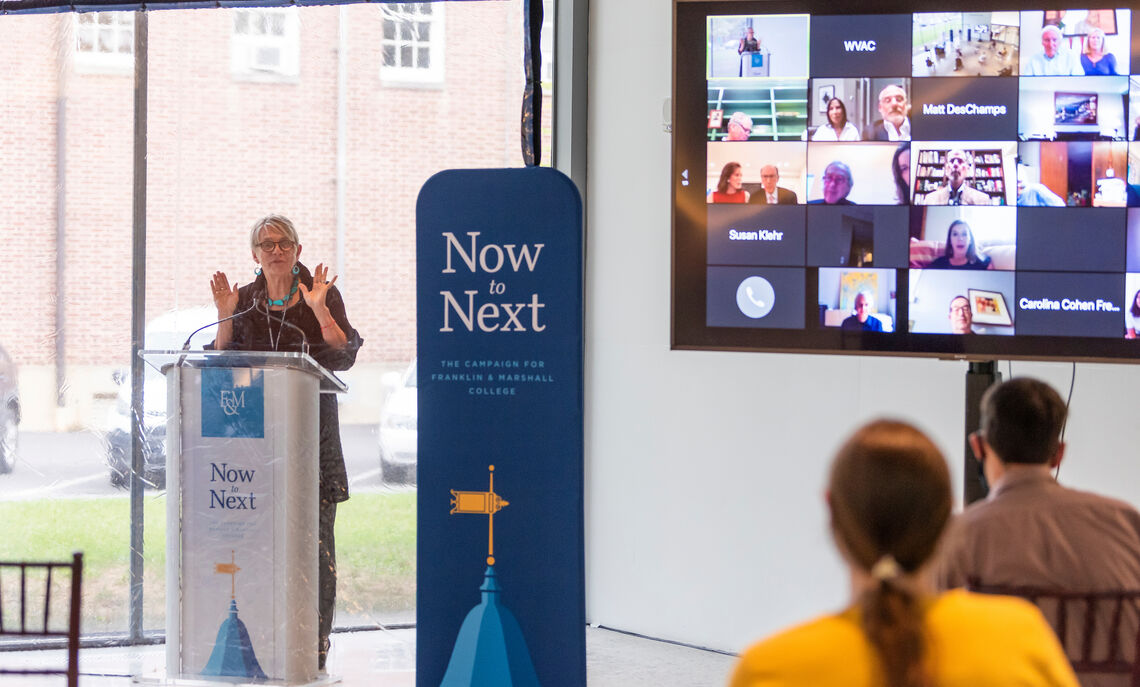 President Barbara Altmann speaks at the blended in-person and virtual champagne toast celebrating the opening of the Susan and Benjamin Winter Visual Arts Center at Franklin & Marshall College.