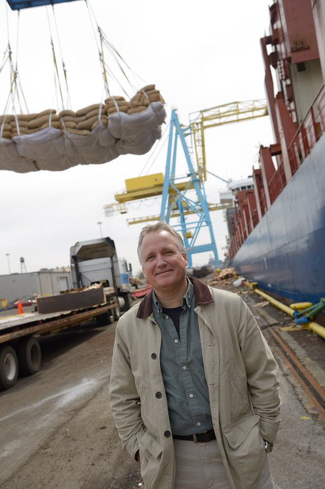 Kip Walk '84 at the Port of Camden, where a crane unloads cocoa beans fresh off a ship from West Africa. Photo by Dave Debalko