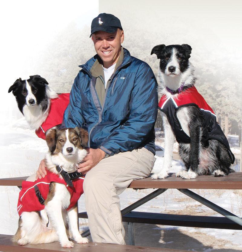 Steve Stochaj '83 and, from left, rescue dogs Striking, Bumper and Splash take a break from winter training in Sunspot, N.M.