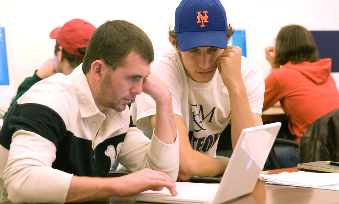 Students studying laptop screen