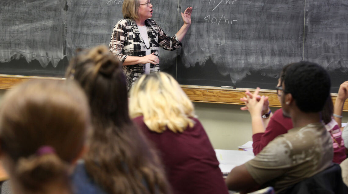 At the blackboard, Alison Kibler, professor of American studies and women's, gender and sexuality studies, says students have been increasingly  selecting women's and gender studies as a minor, which spurred a need to add faculty.