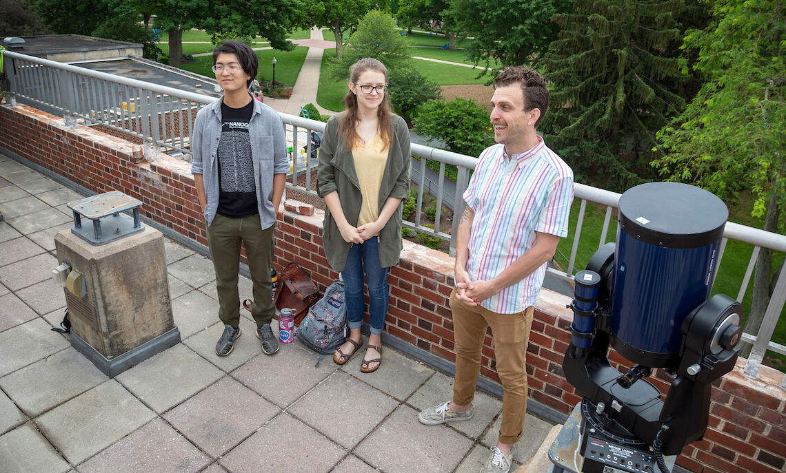 Assistant Professor of Physics Ryan Trainor, right, with rising seniors Issac Lin and Becca McClain, who are performing data analysis on galactic activities from other telescopes and preparing for the JWST data that future F&M students will research.