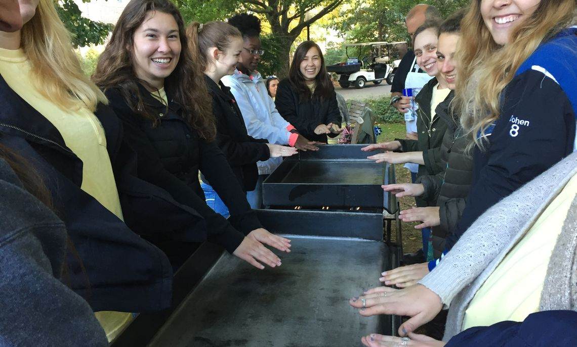 Saturday's sun rose on a morning cold and frosty enough that Kappa Delta sisters warmed their hands over the hot grills as they prepared to flip pancakes for their annual Pinwheels and Pancakes breakfast on Hartman Green.