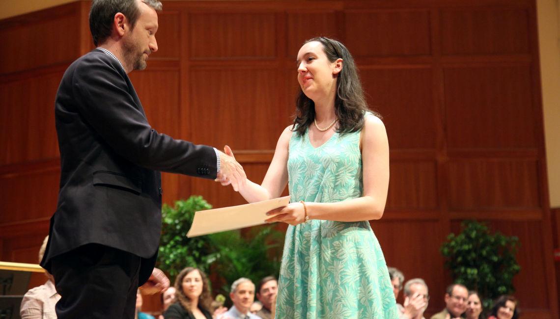 Interim College Librarian Scott Vine presents the inaugural Richard D. Altick '36 Student Research Prize to senior Emily Hawk.