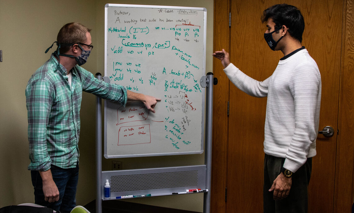 """Prof. Novak and Shaamyl discuss the technical roadmap of the future work and obstacles in their """"dynamic information flow tracking"""" system."""