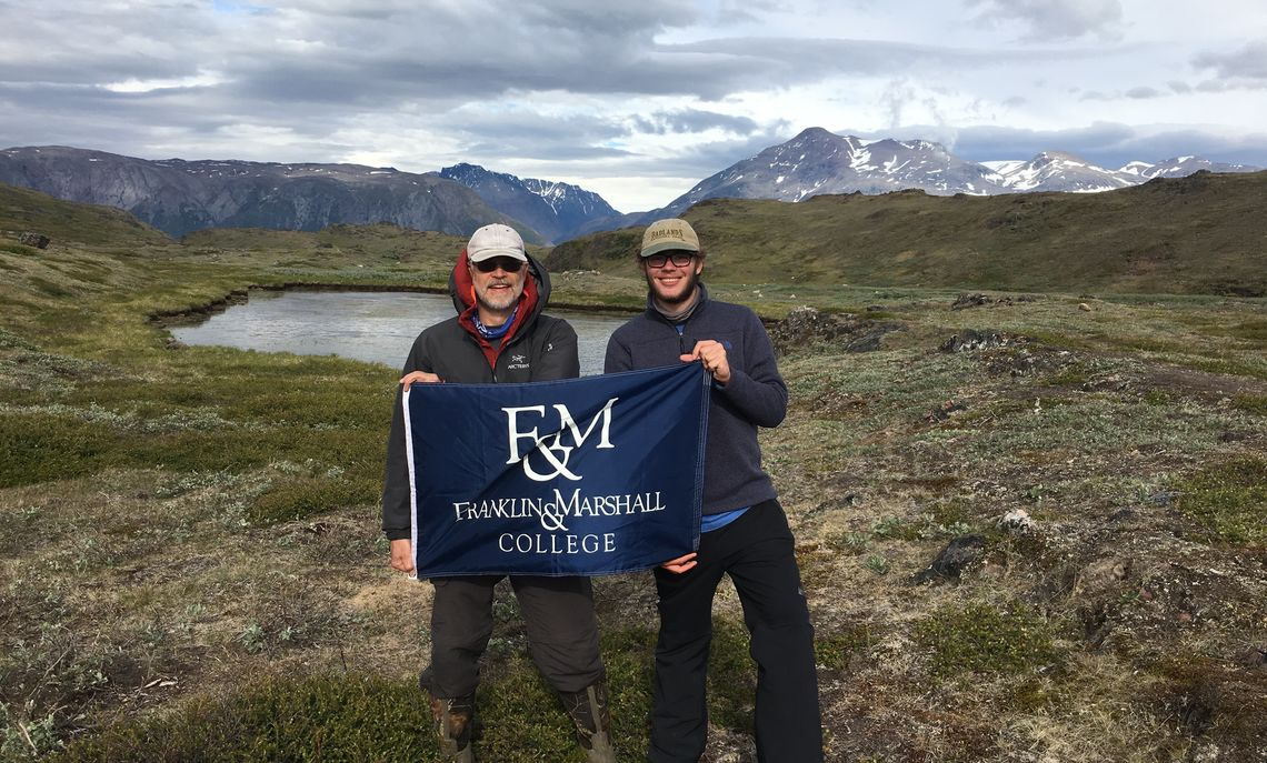 Professor De Wet and Brush near one of Greenland's many lakes, where they conducted some of their research.