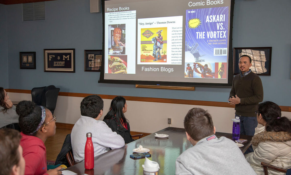 Students at the 'Futurism: Now' presentation of the comic book covers.