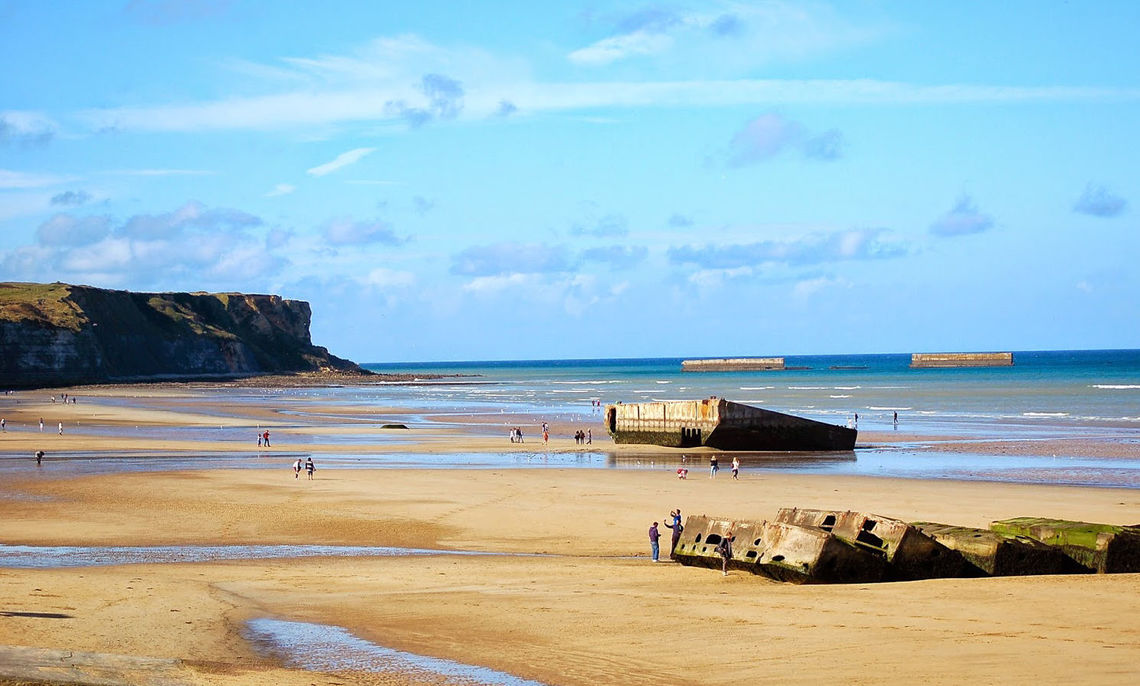 A trip to the Normandy coast brought students to the beaches where American and British troops landed during World War II on D-Day in 1944. Here, at what was then called Gold Beach, the students inspect remnants of Mulberry B, one of the man-made harbors the allies used to ferry supplies and vehicles from ships onto the beachhead.