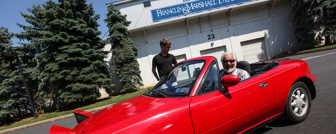 Fred Owens and his red coupe.